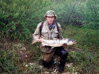 рыболов с рыбой
